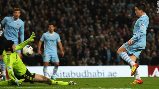 Samir Nasri lifts the ball over Chelsea keeper Petr Cech to seal a dramatic win for Manchester City