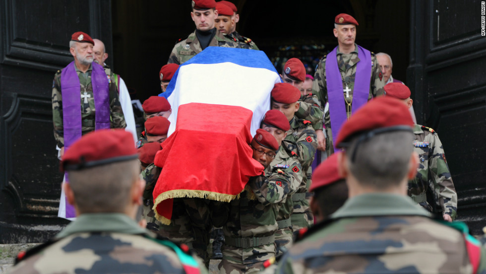 French 17th Parachute Engineer Regiment paratroopers carry the coffin of Abel Chennouf during his funeral at the Montauban cathedral on Wednesday. He was killed in the second attack in Montauban on March 15.