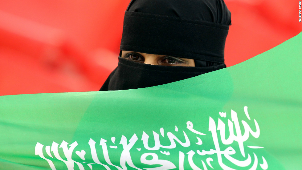A Saudi football fan cheers for her team before the start of the Asian Cup Group B match against Jordan in January 2011.