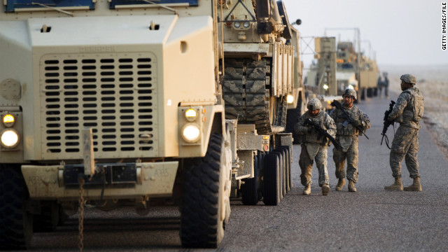 NASIRIYAH, IRAQ - DECEMBER 18: Soldiers with the 3rd Brigade Combat Team, 1st Cavalry Division perform a security check on their Mine Resistant Ambush Protected (MRAP) vehicles near the Kuwaiti border as part of the last U.S. military convoy to leave Iraq on December 18, 2011 near Nasiriyah, Iraq. All U.S. troops were scheduled to have departed Iraq by December 31st, 2011. At least 4,485 U.S. military personnel died in service in Iraq. According to the Iraq Body Count, more than 100,000 Iraqi civilians have died from war-related violence. (Photo by Lucas Jackson - Pool/Getty Images)