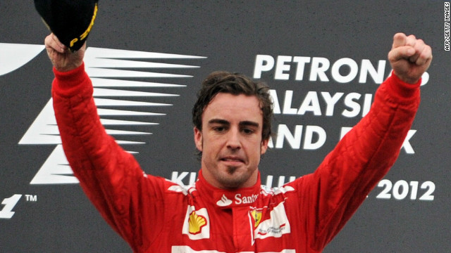 Spain's Fernando Alonso celebrates his victory in the Malaysian Grand Prix at Sepang.