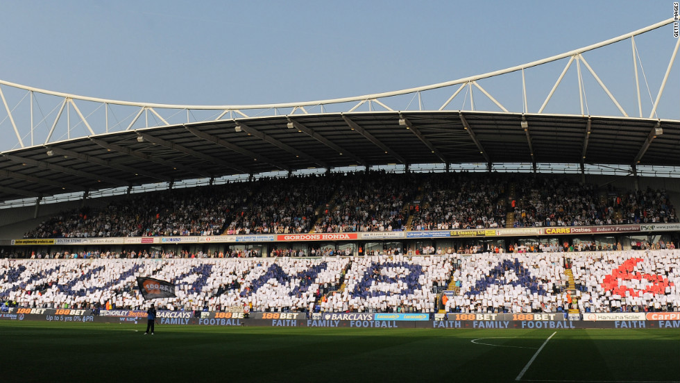 "Fans inside the ground held up cards spelling out ""Muamba 6"" -- his shirt number -- before the game started."