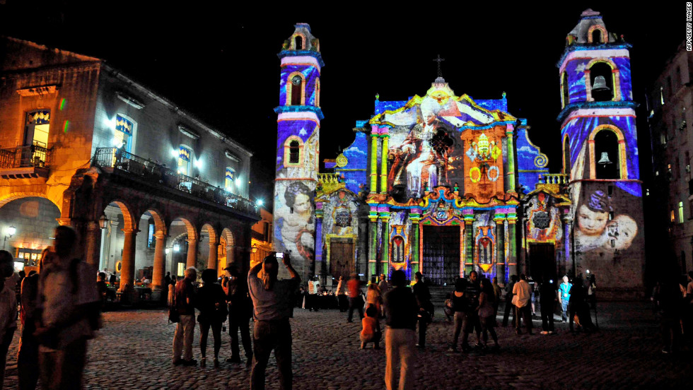 Cubans watch a projection with images of the pope on the walls of a Havana cathedral on Sunday, March 25.