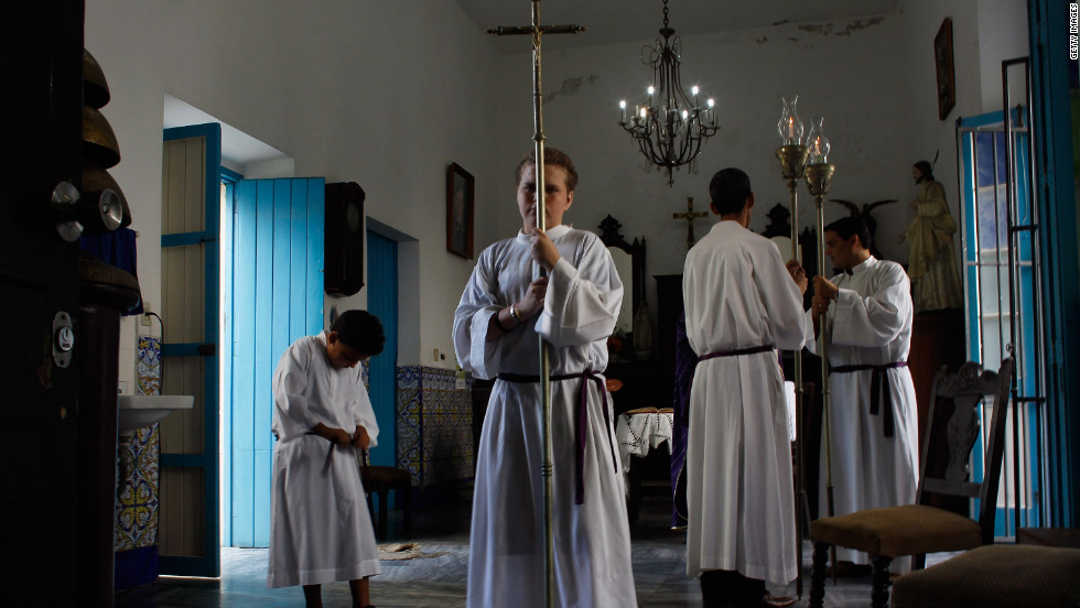 Alter boys prepare for the start of a morning service at Santo Angel Custodio church before the pope's arrival.