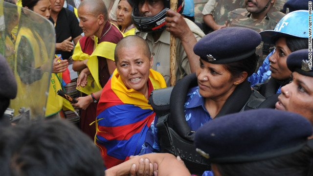 Indian police personnel pushed detained Tibetan protestors onto a bus during a demonstration in New Delhi on March 26.