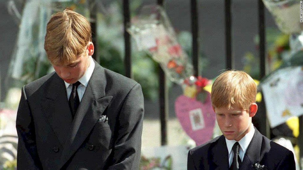 September 1997: Prince William and Prince Harry bow their heads as the coffin carrying their mother Diana is taken out of Westminster Abbey.