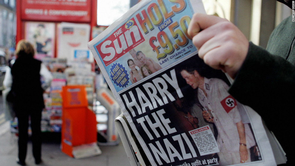 January 2005: A man reads a newspaper with a headline about Prince Harry wearing a Nazi uniform at a costume party.