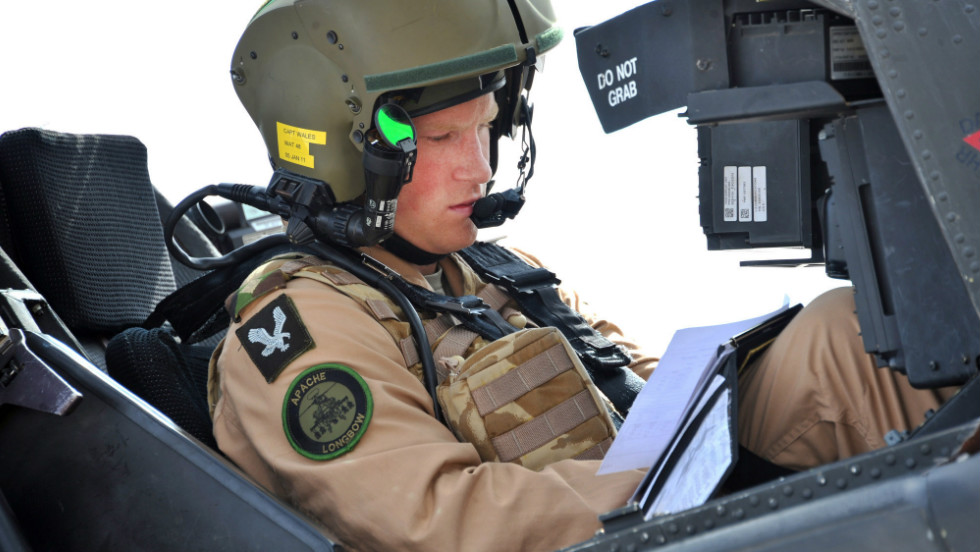 October 2011: Prince Harry prepares his Apache helicopter to go out on a mission in El Centro, California.