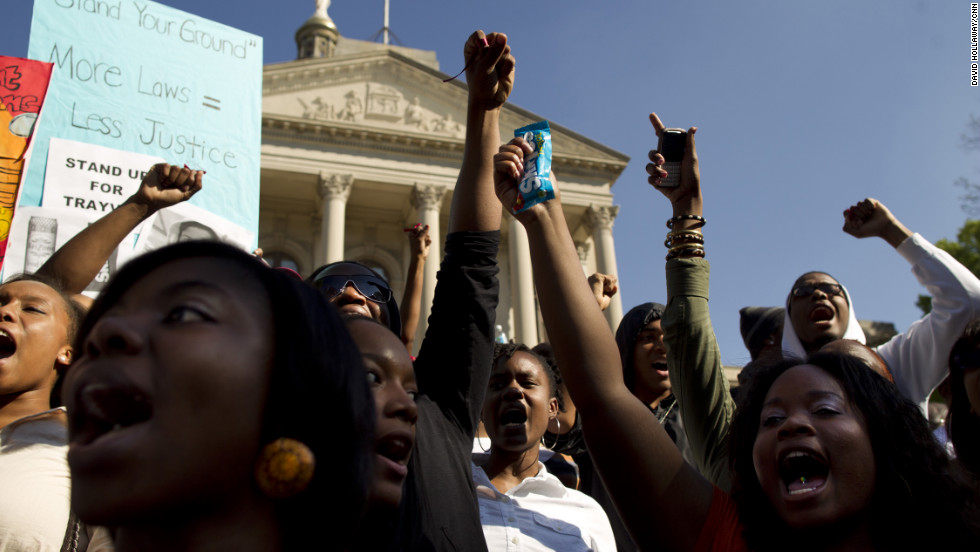 "Thousands of protesters gathered at the ""I am Trayvon Martin"" rally Monday at the state Capitol in Atlanta. Protesters wore hoodies and carried containers of iced tea and bags of Skittles."