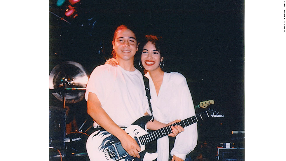 "Selena and her husband Chris onstage with his ""Selena"" guitar.""The next time we played in Austin, Tony bought back my guitar with this gorgeous picture of Selena on it...Selena covered her mouth and her eyes went wide. She was all smiles and totally tripping. 'I can't believe you did that for me!'"" -- excerpt from ""To Selena with Love,"" by Chris Perez."