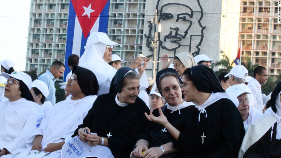 Nuns gather to hear Pope Benedict XVI celebrate Mass in Havana's Plaza de la Revolucion beneath the stenciled gaze of communist icon Che Guevara on Wednesday, March 28.