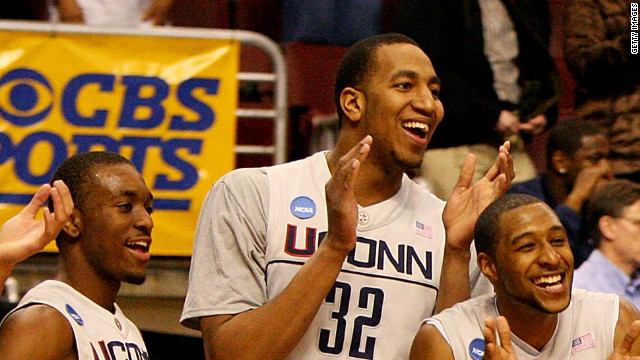 Jonathan Mandeldove (center) cheers during UConn's second-round win in the 2009 NCAA tournament.