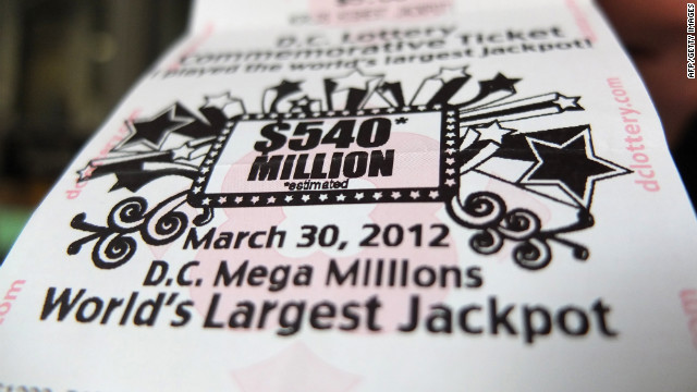 A ticket for the Mega Million US lottery with a record jackpot of $540 million USD is seen in a shop in downtown Washington, DC on Friday.  During the course of the day, the jackpot rose to $640 million.