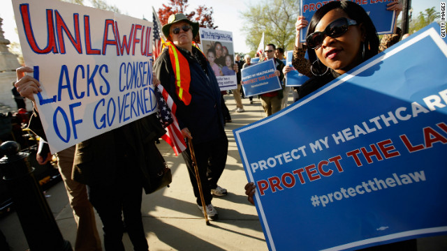 Demonstrators for and against the health care law march and chant in outside the Supreme Court this week.