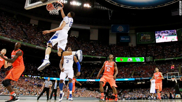 Kentucky's Anthony Davis dunks on Louisville during the Wildcats' 69-61 semifinal victory Saturday night in New Orleans.