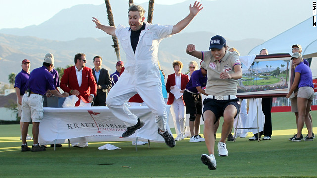 Sun Young Yoo and caddy Adam Woodward take the traditional leap into Poppie's Pond after the Korean won in a playoff
