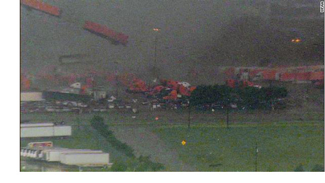 WFAA's helicopter captured this image of a tornado near Lancaster, Texas tossing the trailer of a big rig truck through the air on Tuesday, April 03, 2012.