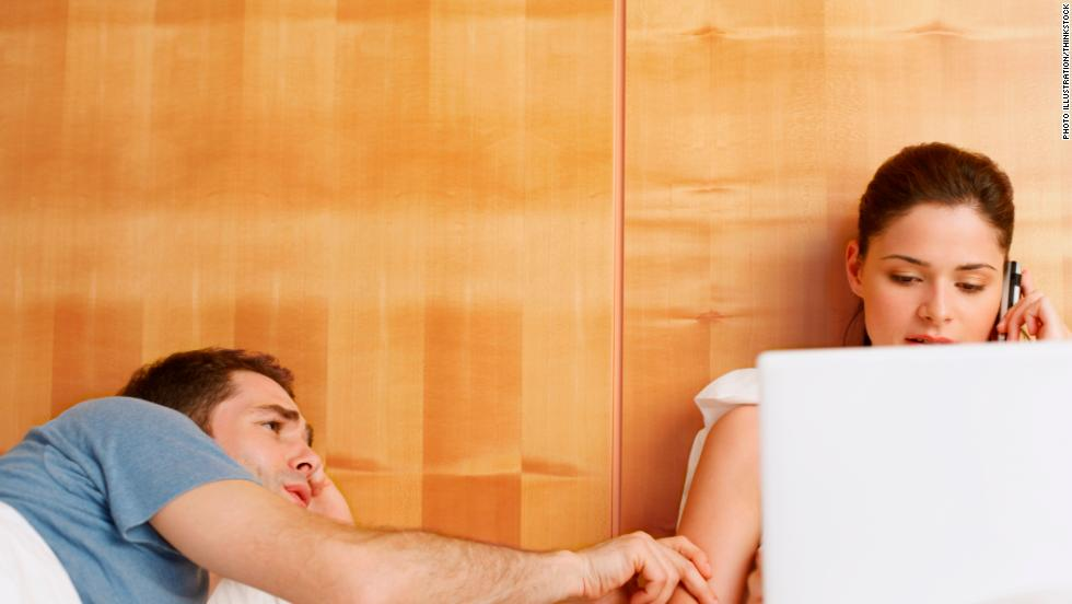 couple bed woman ignoring man