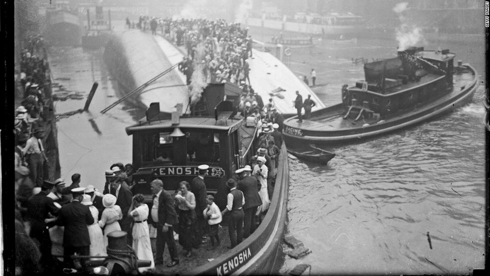 The tugboat Kenosha rescues survivors from the hull of the overturned Eastland steamer in Chicago, Illinois, on July 24, 1915. About 840 people died.