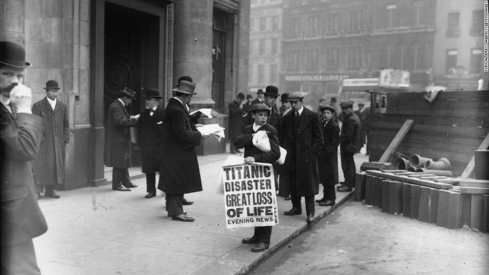 Newspaper boy Ned Parfett sells copies of the Evening News on April 16, 1912 outside the White Star Line offices in London.