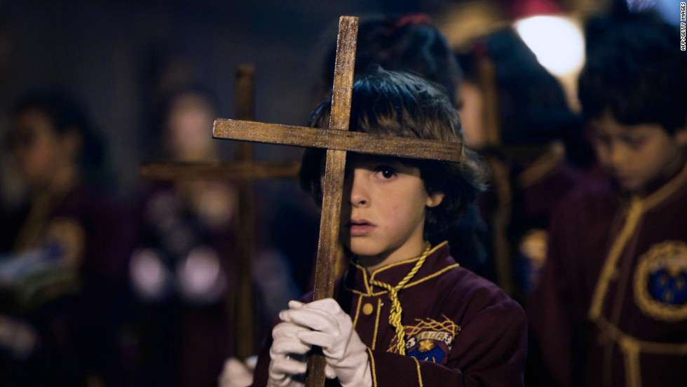 Children take part in a procession of the Padre Jesus Nazareno brotherhood during Holy Week on Tenerife, one of Spain's Canary Islands.
