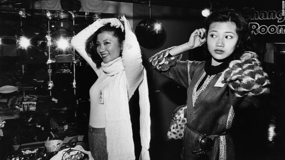 "<strong>Miss Korea and Miss Hong Kong try out Top Shop wares in London, 1977: </strong>""Koreans seem to be more focused on beauty within the face, where Americans are more focused on the body,"" said Jennifer Ko, a 25-year-old Korean artist who says bleached skin, long hair and eyelid surgery are thougtht to be tools of beauty. ""Physical beauty is so important in our culture, especially today. If you are physically beautiful by society's standards you may feel more important and accomplished."""