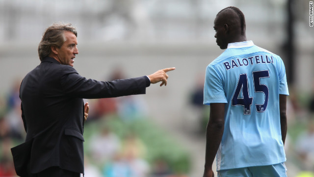 Roberto Mancini sympathizes with his frustrated Manchester City squad, admitting he would punch striker Mario Balotelli.