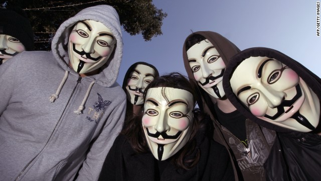 Protesters wearing Anonymous Guy Fawkes masks pose during a demonstration against controversial Anti-Counterfeiting Trade Agreement (ACTA), on February 25, 2012 in Nice, southeastern France