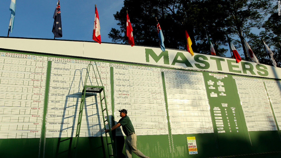 Staff alter the leaderboard during the first round, which saw world No. 3 Lee Westwood take a one-shot advantage.