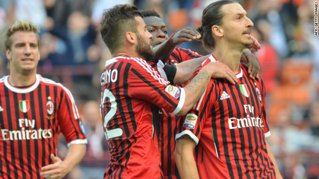 Zlatan Ibrahimovic is congratulated by his AC Milan teammates after scoring the opening goal against Fiorentina on Saturday
