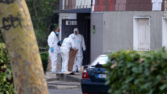 Members of the forensic service of the French police work near where a 47-year-old woman was shot in the head on April 5.