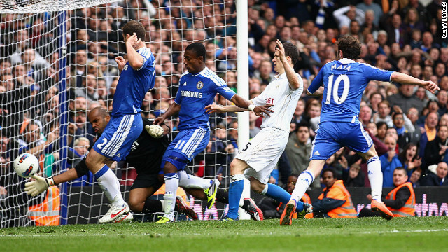 Juan Mata (No.10) scores Chelsea's winning goal against Wigan at Stamford Bridge on Saturday