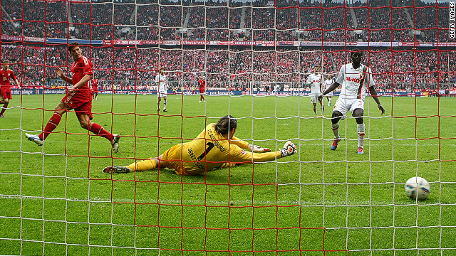 Mario Gomez (left) slots home his second goal in the 2-1 win over Augsburg in the Bundesliga on Saturday