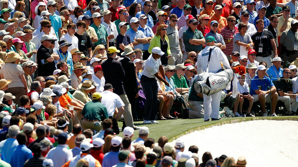 Tiger Woods is surrounded by patrons as he chips onto the ninth green on Saturday. The world No.7 finished the day with a even-par round of 72 to leave him three-over for the tournament and well off the pace.