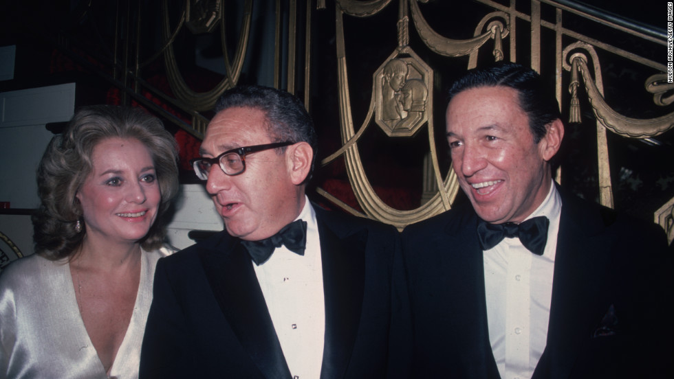 Barbara Walters,  Henry Kissinger and  Wallace pose for a photo at the Waldorf Astoria Hotel in New York City in 1980.