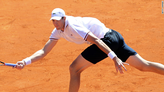 John Isner makes a return during his decisive win over Jo-Wilfried Tsonga in their Davis Cup tie.