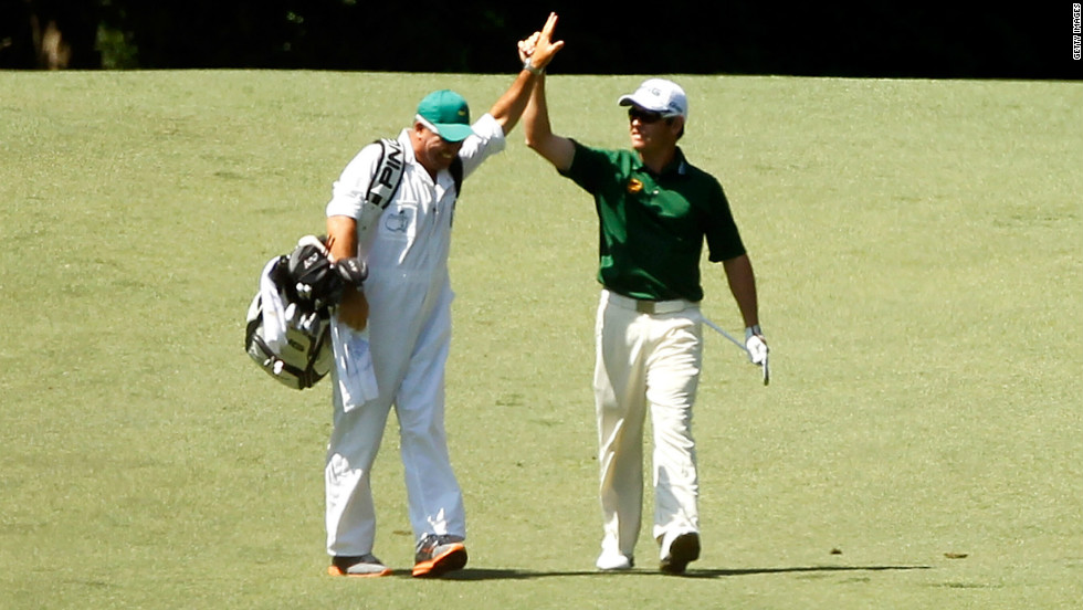 Louis Oosthuizen celebrates his double eagle from the second fairway in the final round of the Masters at  Augusta National.