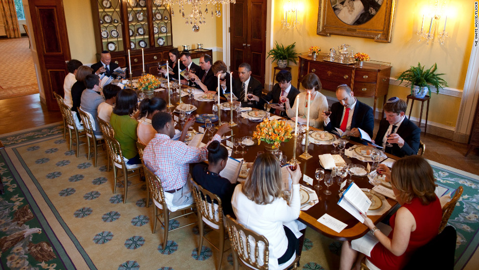 President Barack Obama and first lady Michelle Obama host a Passover Seder dinner for family, friends and staff in the Old Family Dining Room at the White House on Friday.