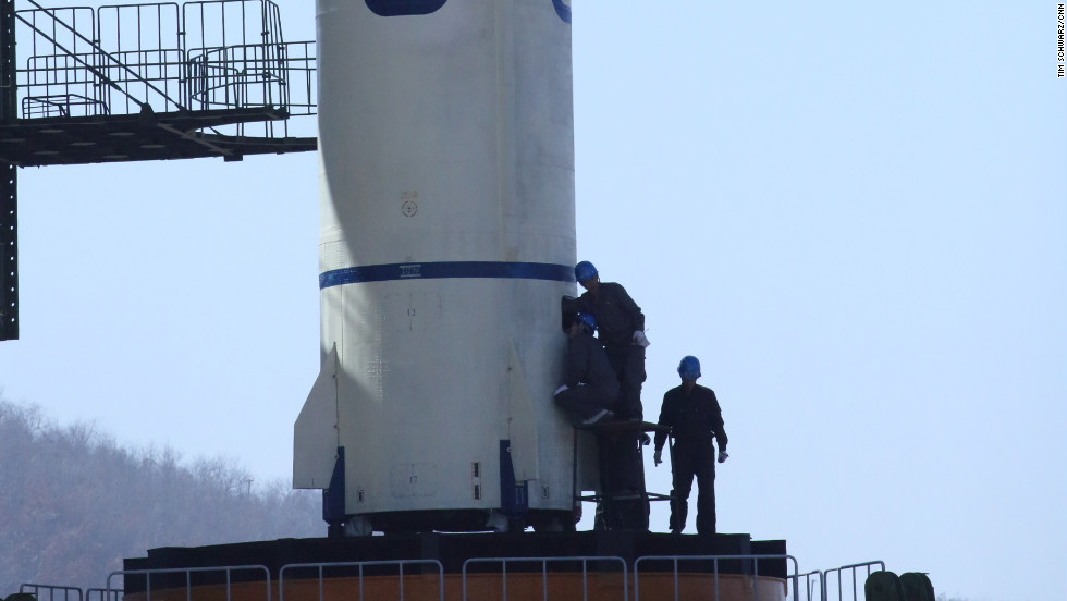Technicians check the North Korean satellite launch vehicle Unha-3 on the launch pad at the Sohae Satellite Launching Center on April 8.