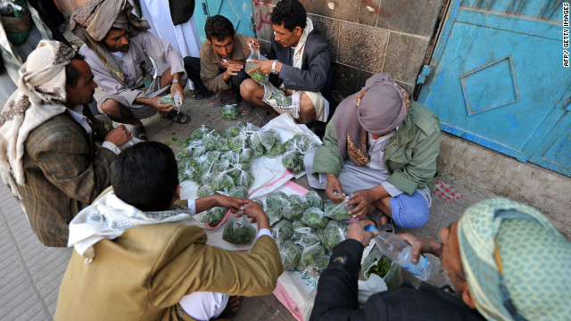 A Yemeni vendor displays qat leaves, a popular mild narcotic plant, for sale at an outdoor market in Sanaa.