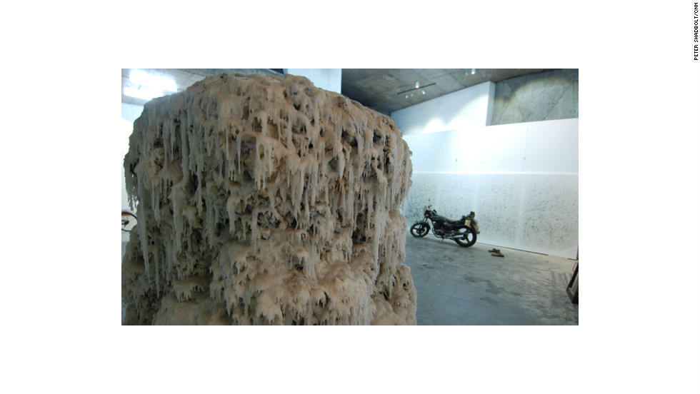 A wax-covered stalagmite of stacked calligraphy sits in the Yangjiang Group's studio.