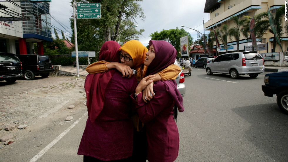 Women hug each other after Wednesday's earthquake that struck roughly 270 miles from Banda Aceh, which was devastated by a tsunami in 2004.