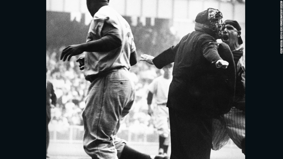"Yogi Berra takes issue with the umpire's ""safe"" call after Jackie Robinson's electrifying steal of home in Game 1 of the 1955 World Series. Today, Berra is often regarded a cuddly old ambassador for baseball. Back then, when the game was on the line, Yogi Berra was known as a bad, bad man<strong>.<br /><strong></strong><br /><strong></strong>See the entire gallery of photos on LIFE.com</strong>"