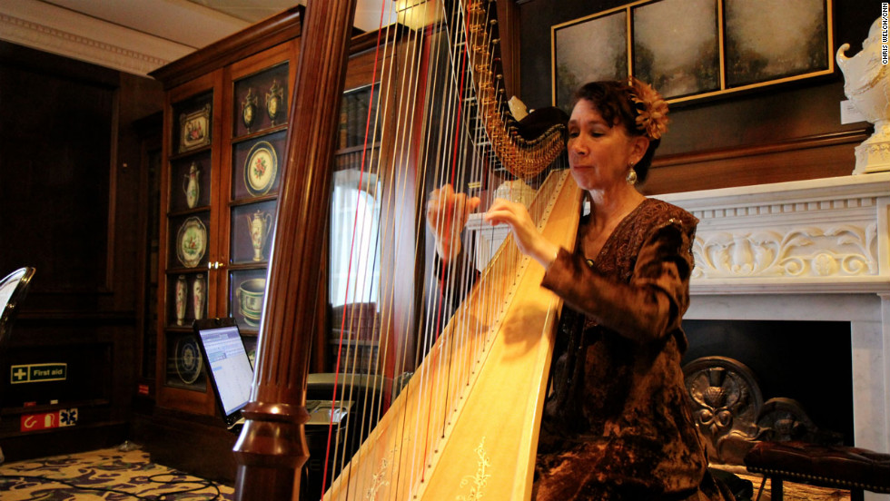 Mary Amanda Fairchild plays the harp aboard the Azamara Journey.