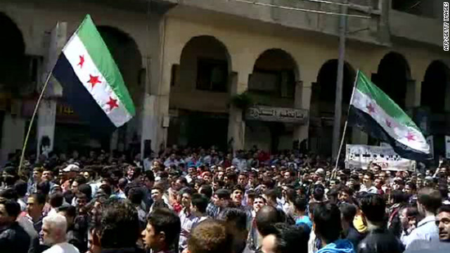 An image grab taken from a video uploaded on YouTube shows Syrians demonstrating in the Damascus suburb of Duma on April 13, 2012.