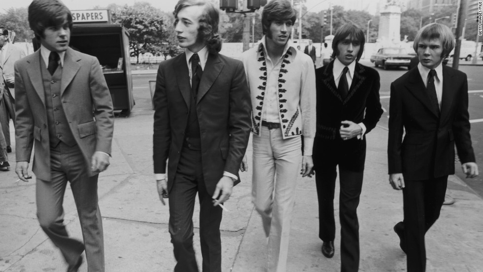 The Bee Gees walk down a New York City Street in 1968. From left to right, bassist Vince Melouney, Robin Gibb, Barry  Gibb, Maurice Gibb, and drummer Colin Peterson.
