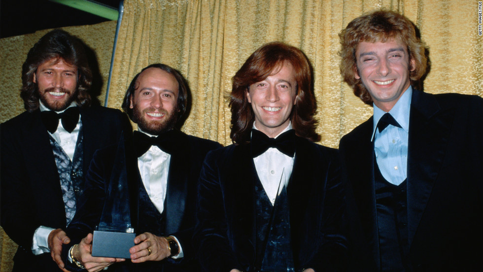 The Bee Gees pose with Barry Manilow at the American Music Awards in1979. Manilow won the award for Favorite Pop/Rock Male Artist, and the Bee Gees won Favorite Pop/Rock Band, Duo, or Group.