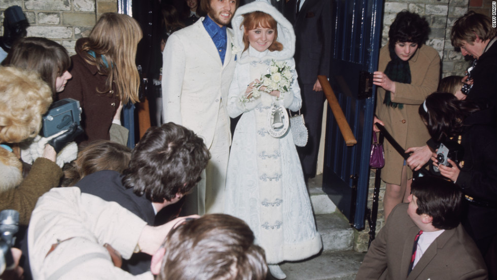 Maurice Gibb and his new bride, Scottish pop singer Lulu, exit Gerrards Cross Church in  Buckinghamshire, England, on February 18, 1969.