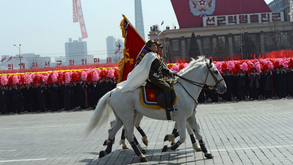 Mounted North Korean military personel take part in the  parade.