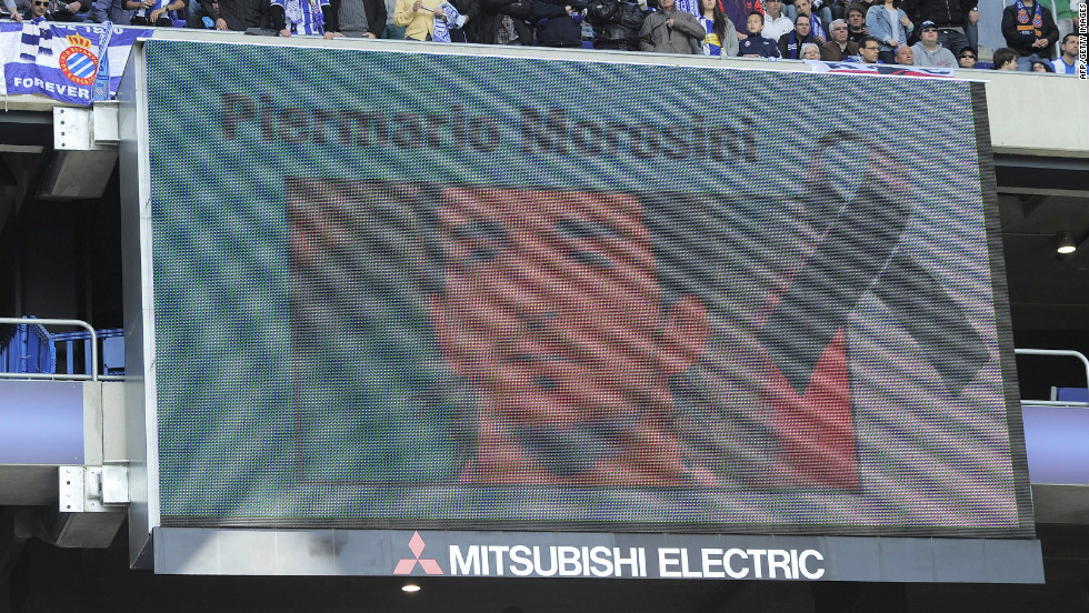 Piermario Morosini's face is projected on the big screen before Sunday's La Liga game between Espanyol and Valencia. The Spanish teams observed a minute's silence in memory of the Italian midfielder, who died after a suspected heart attack on Saturday April 14.